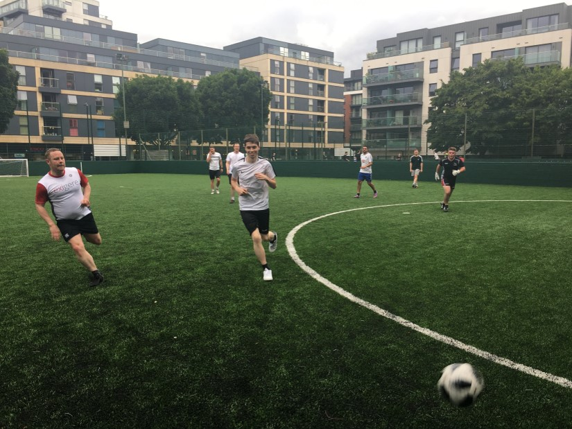 exigere staff playing 5-a-side football at Parkeray Charity tournament
