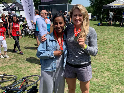 Exigere's Yohana Tekle holding her medal at the JLL Property Triathlon.