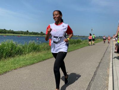 Exigere's Yohana Tekle running for women's team at the JLL Property Triathlon 2019.